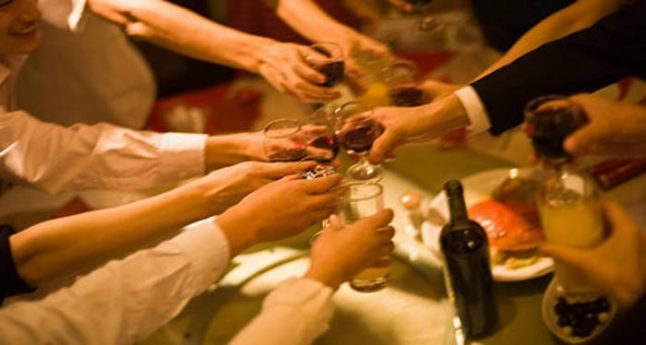 French booze less but spend more on alcohol