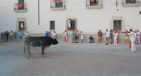 Bull shot in the street at fiesta after goring man