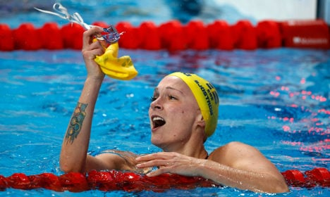 Sweden's golden girl swims to new record