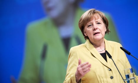 Merkel defends tough line on Greece