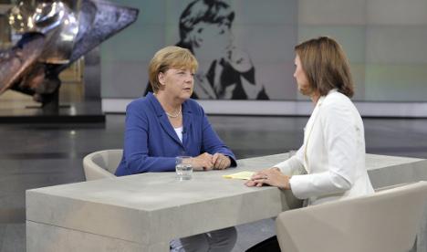 Merkel: Migrants bigger challenge than Greece