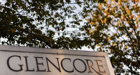 Glencore posts heavy losses in first six months