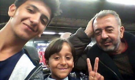 Syrian father and son tripped up by camerawoman find home in Madrid