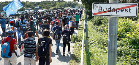Buses of refugees arrive in Austria
