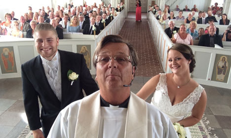 Swedish priest scores fame with wedding selfie