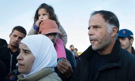 Danes hold refugees set for Sweden in school
