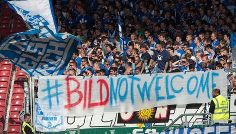 Football fans show anger at Bild over refugees