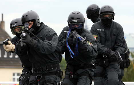 Elite cops destroy offices in chainsaw tantrum