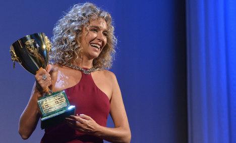 Valeria Golino wins best actress prize in Venice
