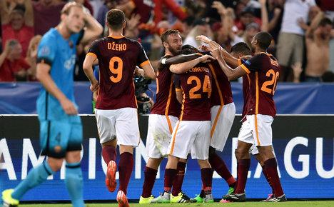 Florenzi stunner helps Roma hold Barca
