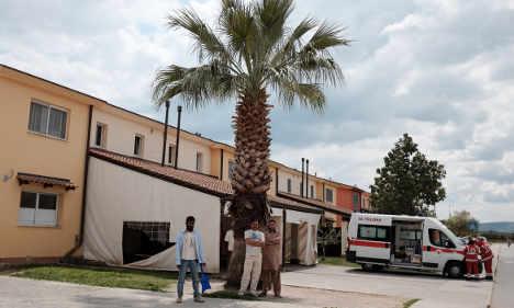 Sicily double murder suspect faces judge