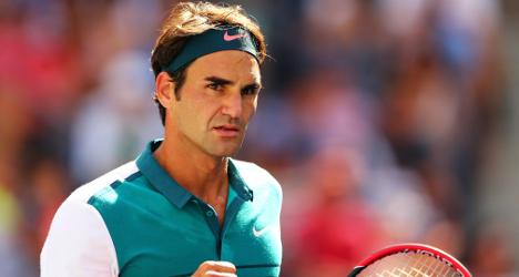 Federer sets up clash with big serving Isner