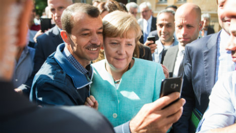 Let's get refugees working quickly: Merkel