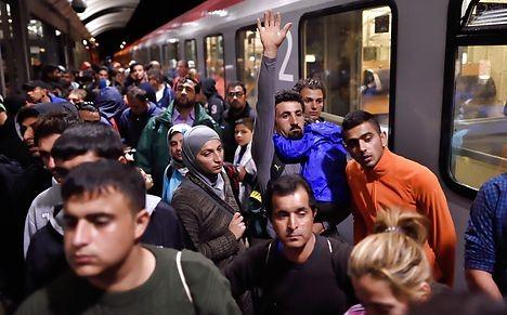 Refugees flee Danish police for Sweden