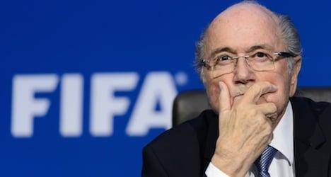 Blatter vows to stay on despite criminal probe
