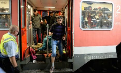 Merkel promises states 'orderly' refugee deal