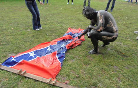 Danish artist in blackface burns Confederate flag