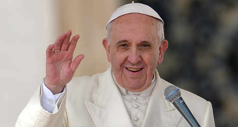 Pope makes surprise visit to central Rome