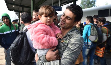 Merkel 'proud' as govt plans €6bn for refugees