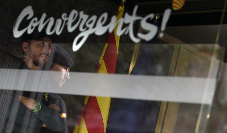 Police arrest treasurer of Catalonia separatist party in corruption probe