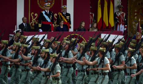 Spanish royals celebrate national day military parade amid protests