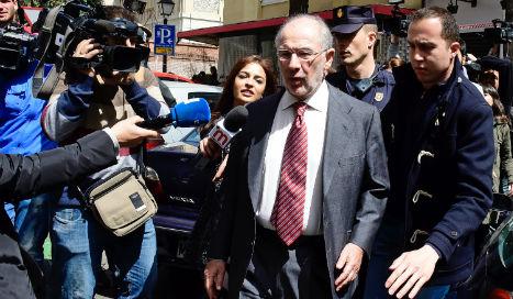 Judge withdraws passport of ex-IMF chief Rato in corruption case