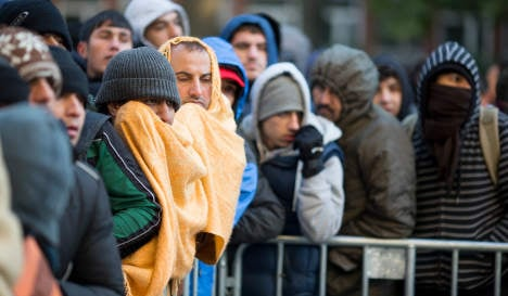Frustrated migrants take refugee centre to court