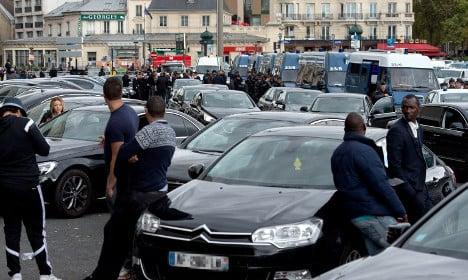 Paris Uber drivers protest fare reductions