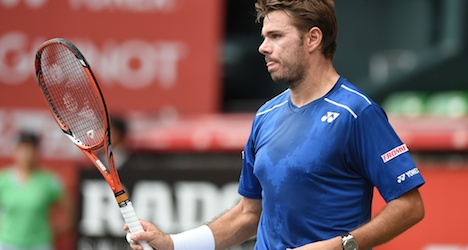 Wawrinka muscles through to Japan victory