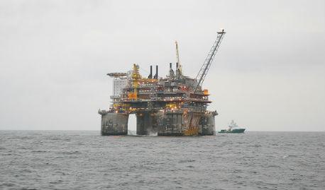 Norway to tap oil fund as revenues plummet