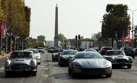 Iconic James Bond cars parade through Paris