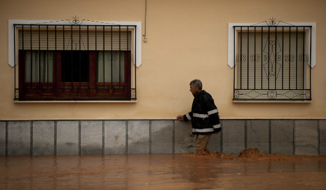 Schools closed and roads flooded as fierce storms batter southern Spain