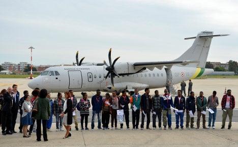 First asylum seekers leave Italy under EU plan