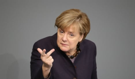 Merkel tries to hit tough-but-fair note on refugees