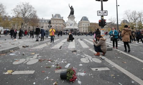 Anger as protesters trash Paris attacks memorial
