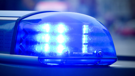Police arrest armed men at German school