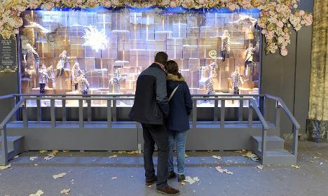 Shocked Parisians shun big stores after attacks