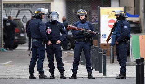 Woman blows herself up in Paris police raid