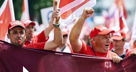 Construction workers walk off Zurich job sites