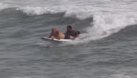 Dramatic video shows hero surfer rescue drowning man in Barcelona