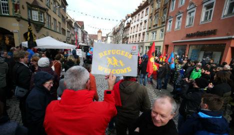 Protesters clash after German grenade attack