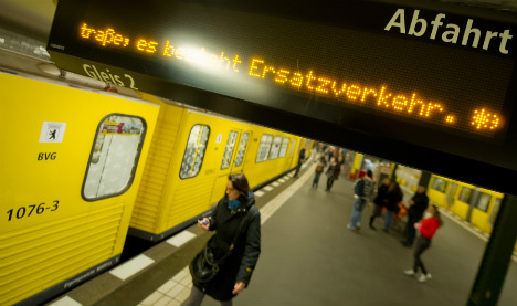 Passengers grab man who 'shoved woman under train'