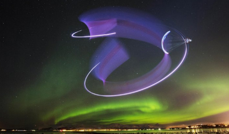 Spanish paraglider dances in the sky with Northern Lights