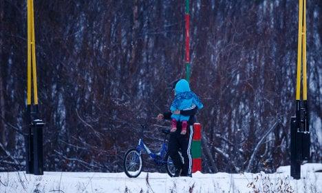 Norway suspends return of migrants from Russia