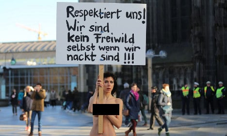Swiss artist stages nude protest in Cologne