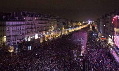 Defiant French throng Paris to bid adieu to 2015