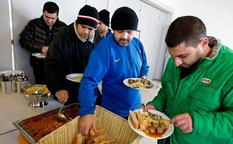 EU tells Denmark to explain plans to take refugees' cash