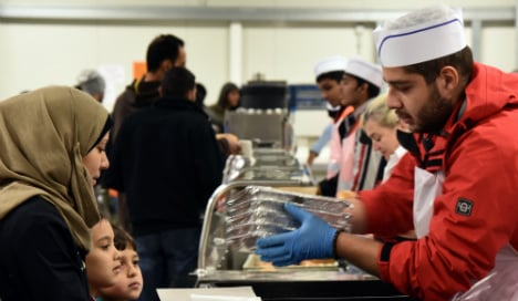 Germany's big surplus to cover costs of refugees