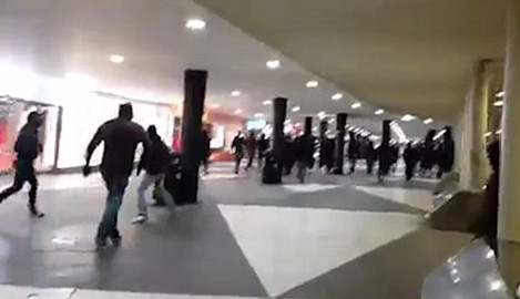 Masked marchers beat immigrants in Stockholm