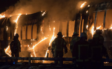 Hunt for cause of fire that gutted Berlin train